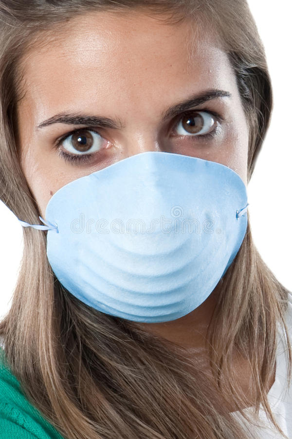 Girl infected with influenza A. And mask isolated over white royalty free stock photo