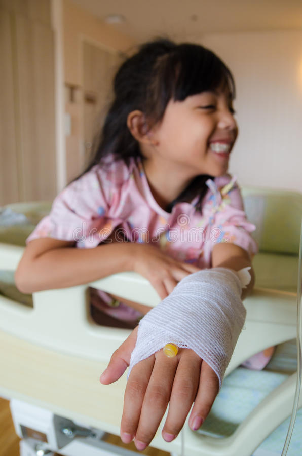 Girl with injured hand stock photos