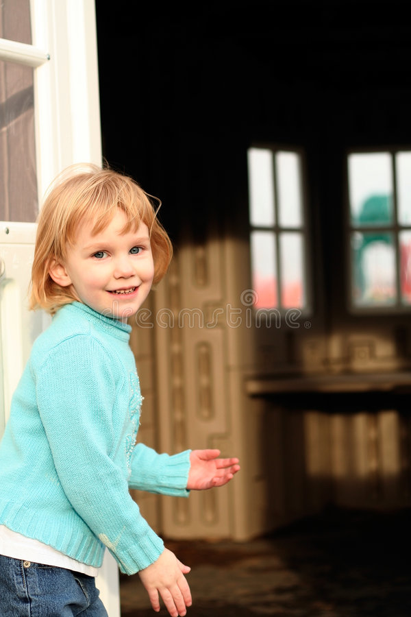 Girl invites to playhouse stock photography