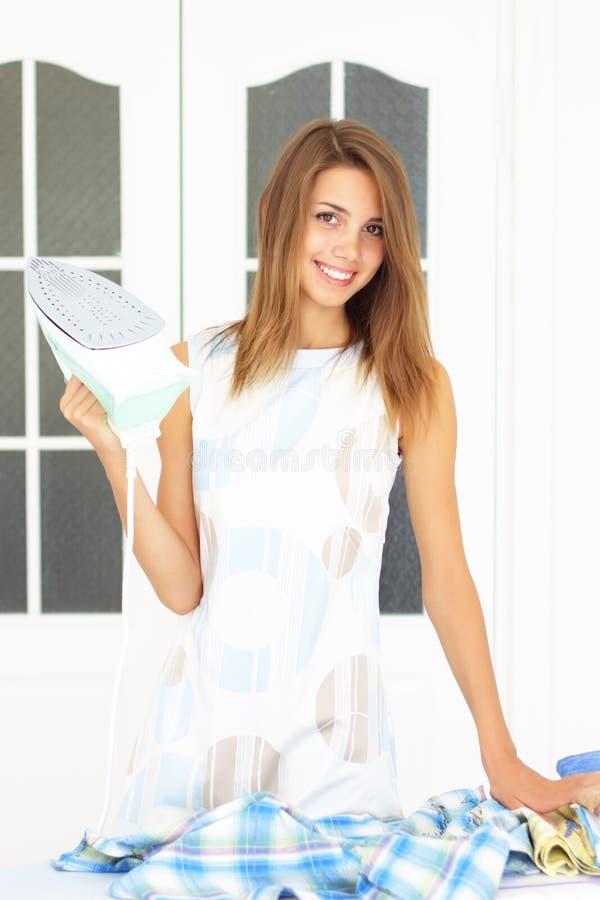 Download Girl ironing stock image. Image of studio, happiness - 15608271