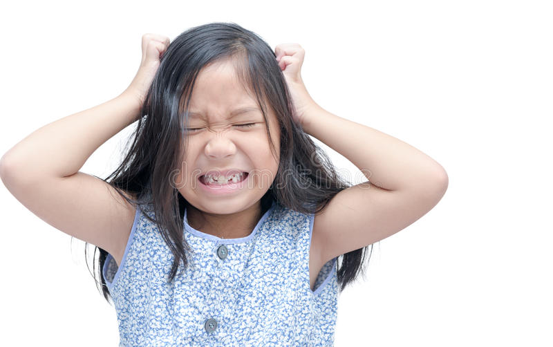 Girl itchy his hair on isolated white. Background stock image