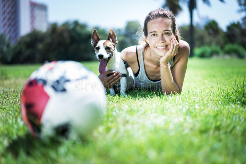 Girl with jack russel terrier royalty free stock photography