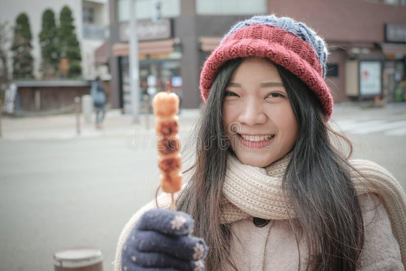 Girl with Japanese snack name Kibi Dango stock image