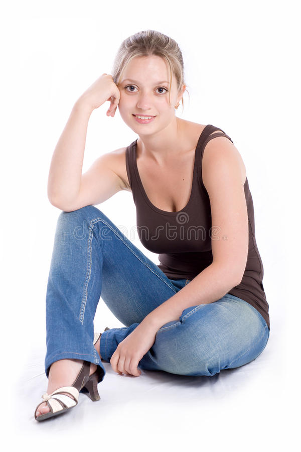 The girl in jeans. Beautiful young girl in jeans and a vest royalty free stock photos