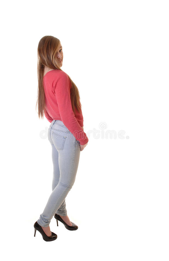 Girl in jeans and sweater. stock image
