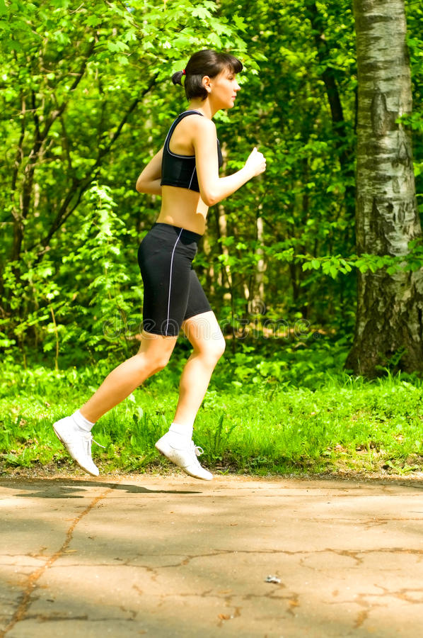 Girl jogging royalty free stock photo