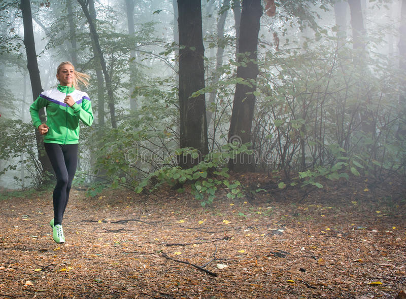 Download Girl jogging stock photo. Image of cold, smiling, motion - 27246076