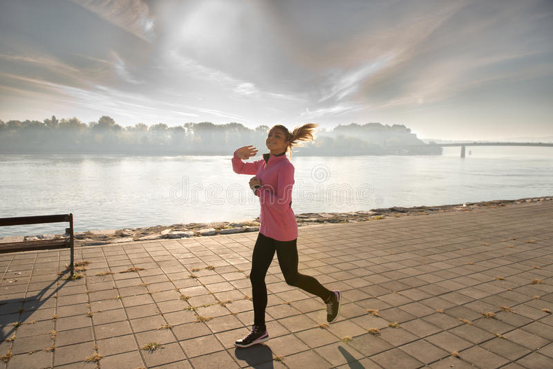 Download Girl jogging stock image. Image of clouds, adult, outside - 27284347