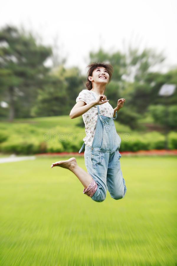 Girl in a jump royalty free stock photography