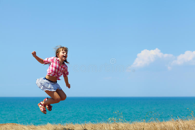 Girl in a jump stock photography