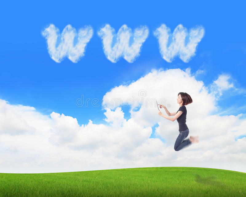 Download Girl Jump And Using Tablet Pc With Www Cloud Stock Photo - Image: 23514790
