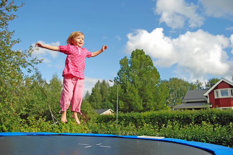 Girl jumping stock photos