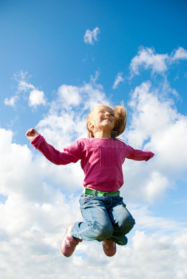 Download Girl jumping stock image. Image of jeans, little, person - 24819501
