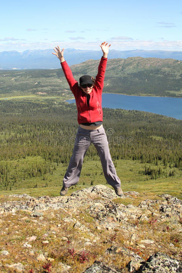 Girl jumping in the air royalty free stock image
