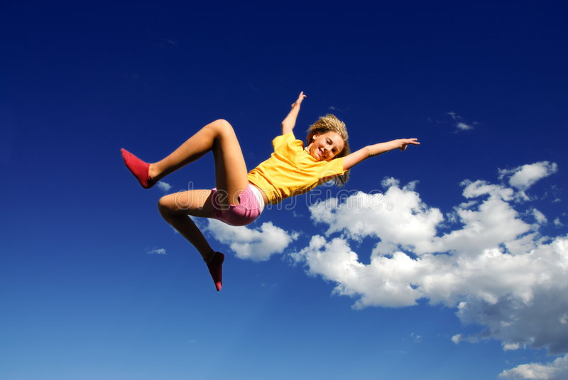 Girl jumping in air stock photo