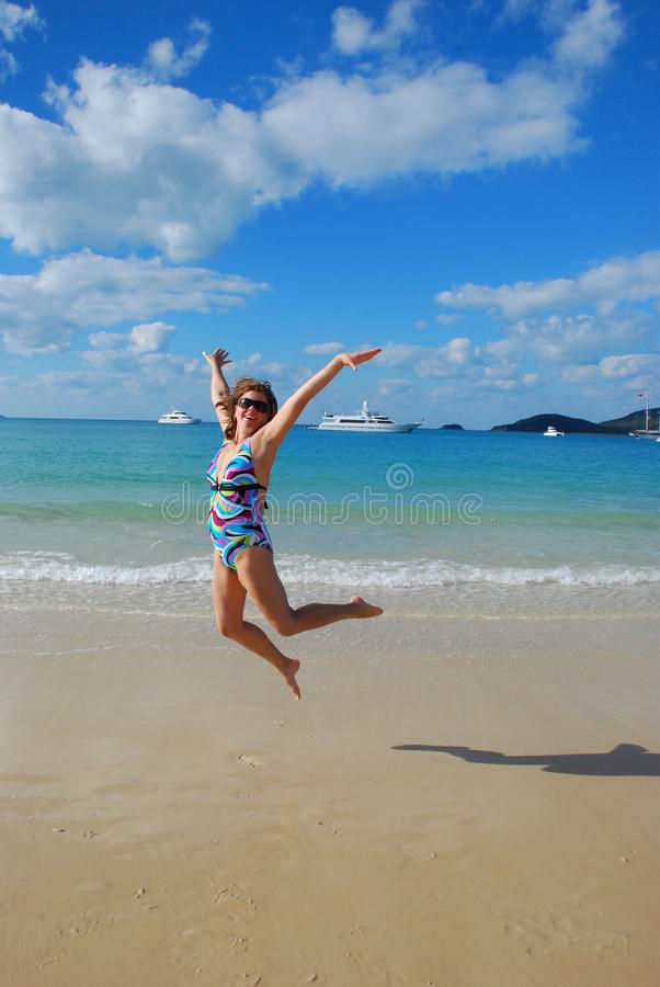 Download Girl jumping on the beach stock photo. Image of relaxing - 20916506