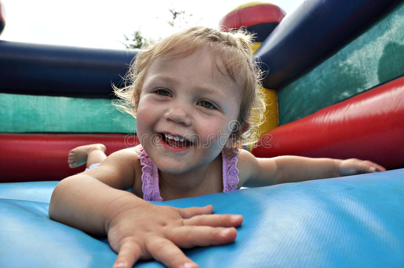 Girl on Jumping castle royalty free stock photos