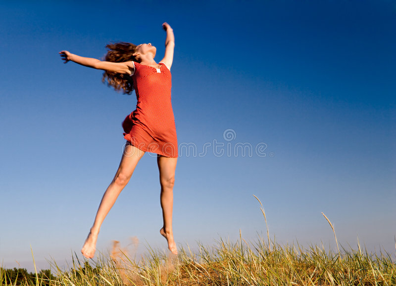 Girl jumping on a dune-1 stock images