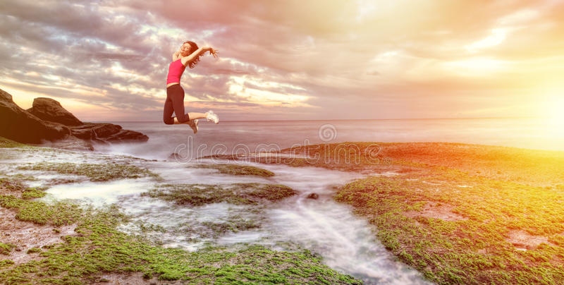 Girl jumping royalty free stock image