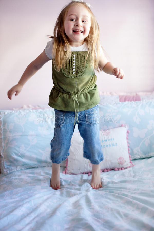 Download Girl Jumping On Her Bed Stock Photos - Image: 14064293
