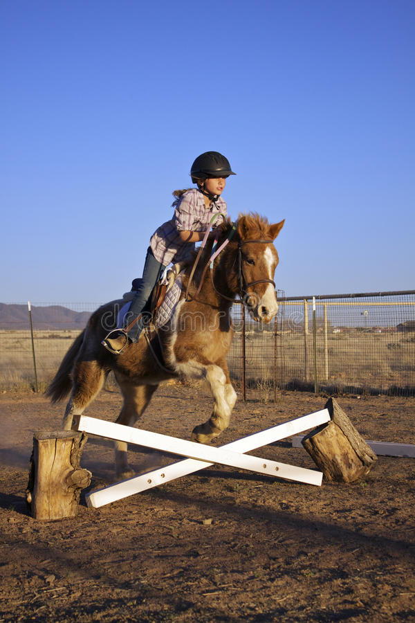 Free Girl Jumping Her Pony Stock Photos - 24188263