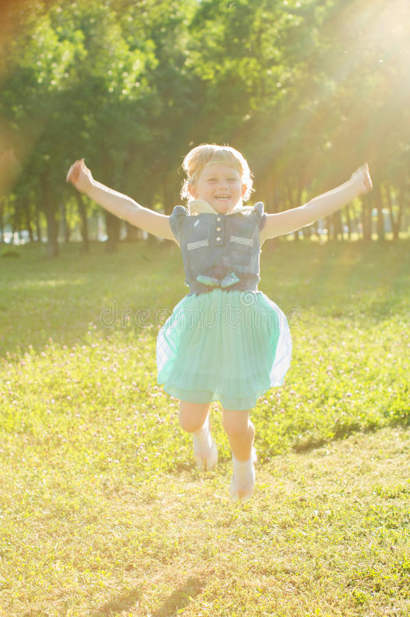 Girl jumping on the nature stock images