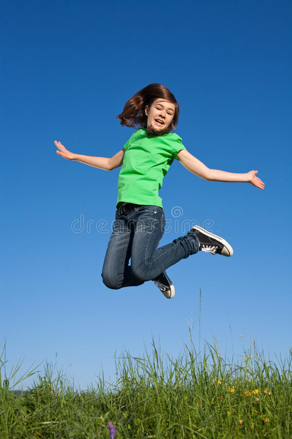 Girl jumping outdoor stock photography