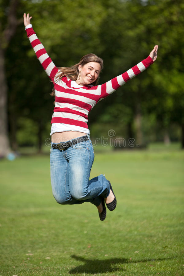 Download Girl jumping outdoors stock photo. Image of girl, young - 12000464