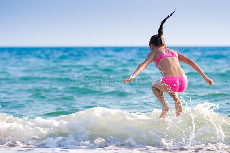 Girl Jumping Over Sea Wave. Summer, Vacation Stock Image