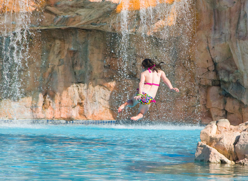 Download Girl jumping into pool stock photo. Image of tourist - 13853612