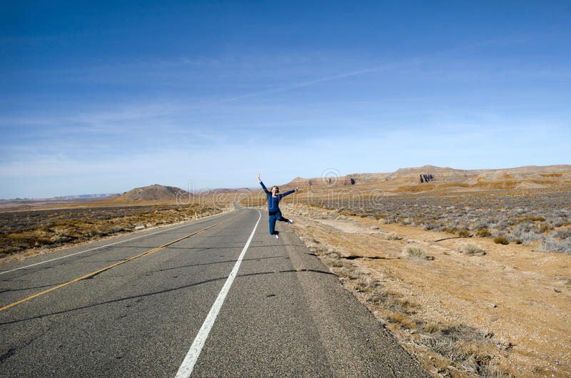 Girl jumping in road royalty free stock photography