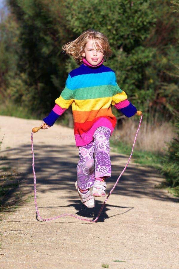 Girl jumping rope royalty free stock photos