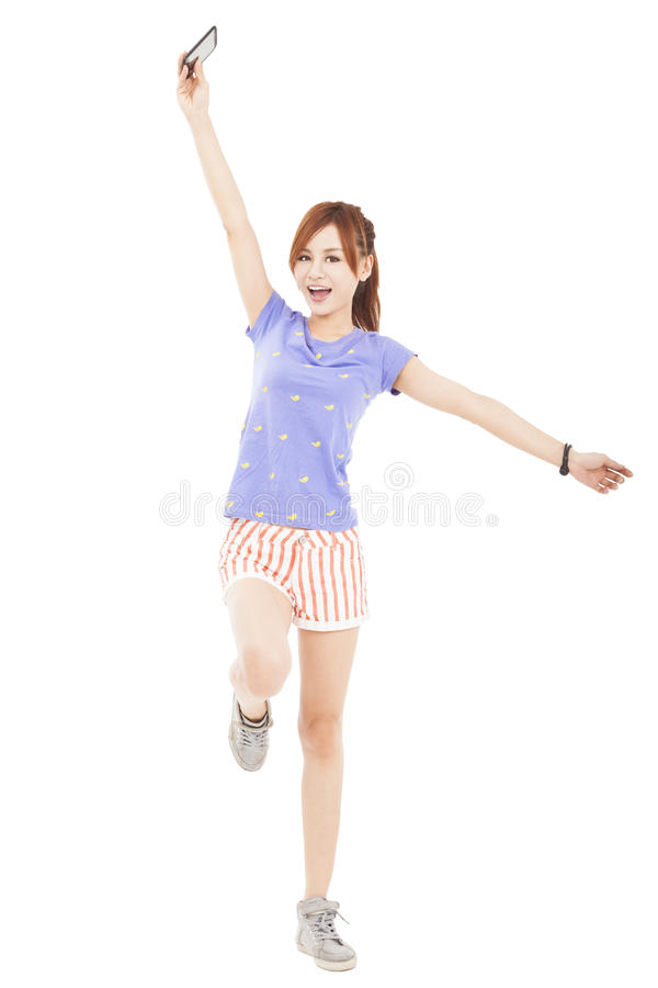 Download Girl Jumping With Smart Phone In The Hand Stock Photo - Image: 31283530