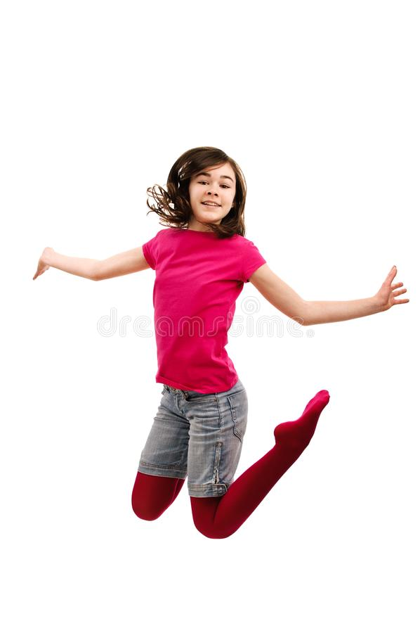 Girl jumping isolated on white background. Girl jumping on white background royalty free stock image