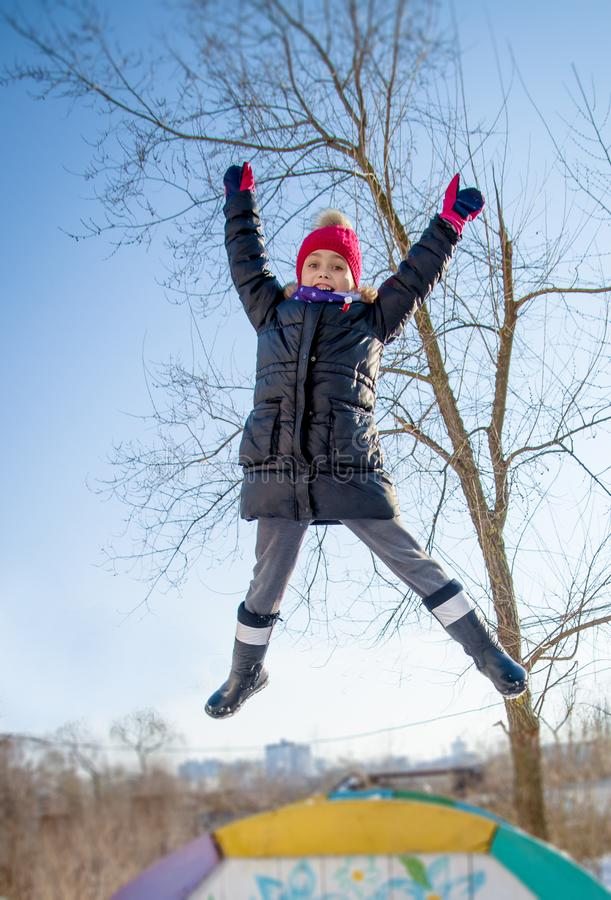 Girl jumping in winter stock images