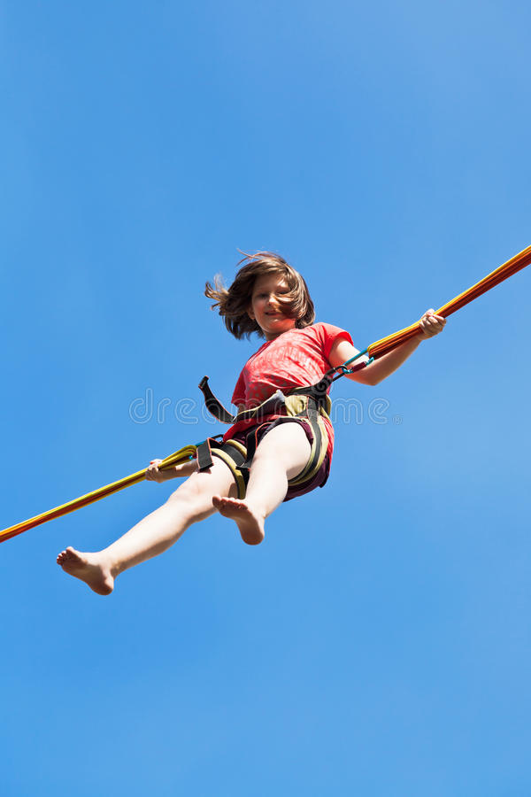 Girl Jumps On Bungee Cord Stock Photo