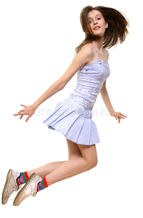 Girl jumps onward. On a white background stock image