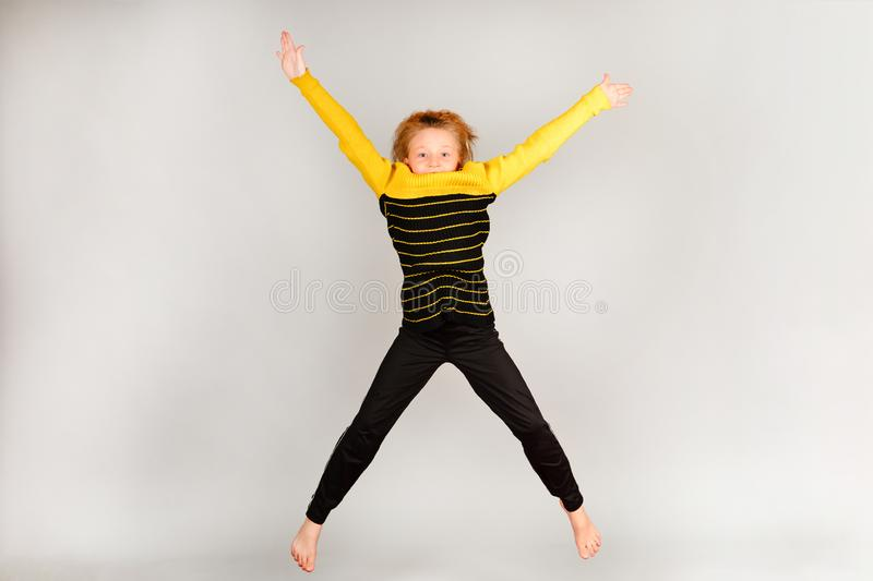 The girl jumps up, arms and legs in different directions stock images