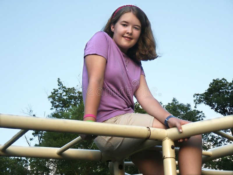 Girl on jungle gym royalty free stock photography