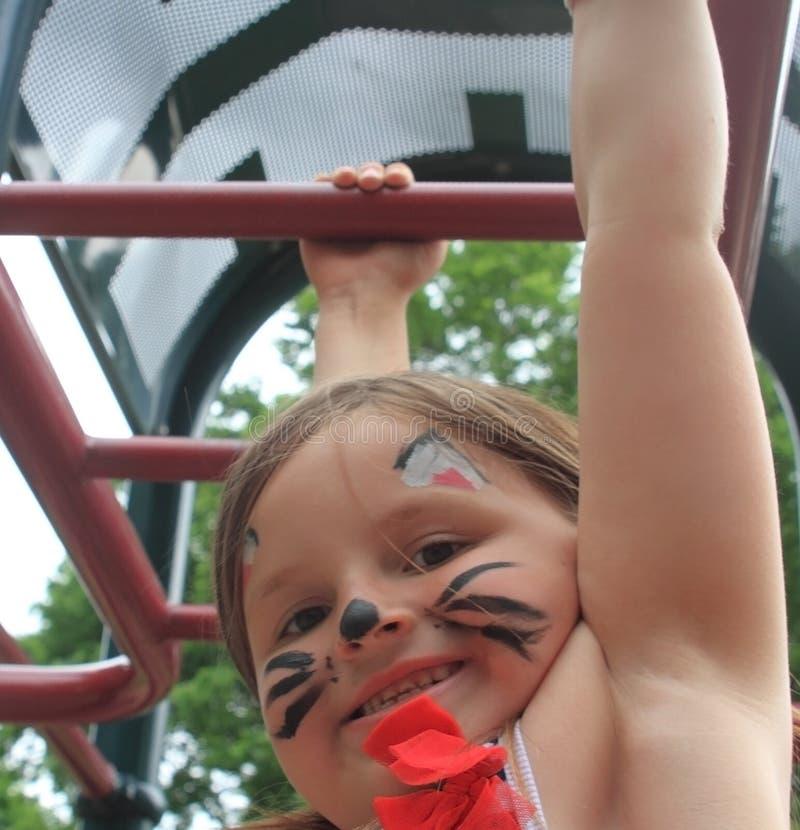 Girl on jungle gym at playground stock photo
