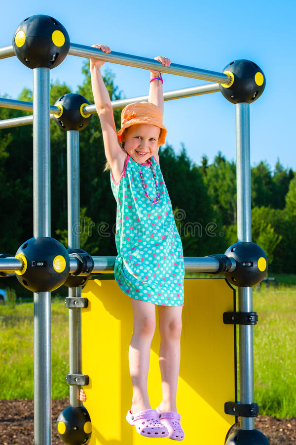 Girl and jungle gym royalty free stock photo