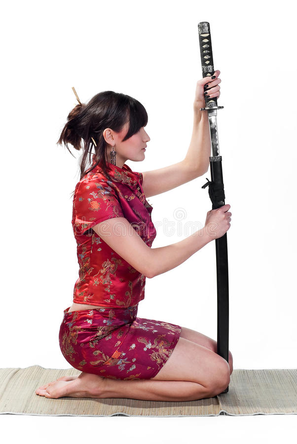 Girl with katana. Beauty and resolute asian girl with katana isolated on white background stock images