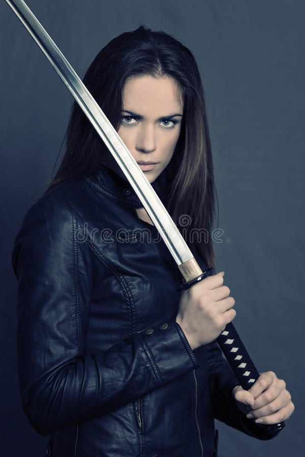 Girl with Katana. In studio royalty free stock photography