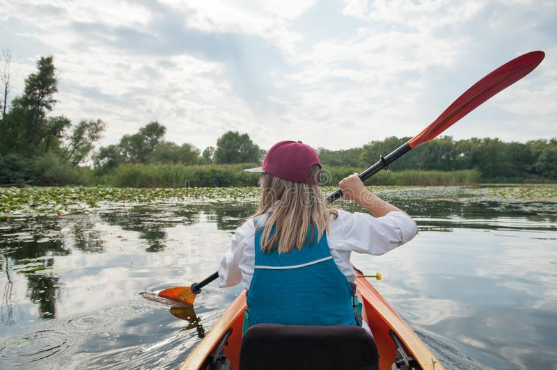 Girl in a kayak on a river stock images