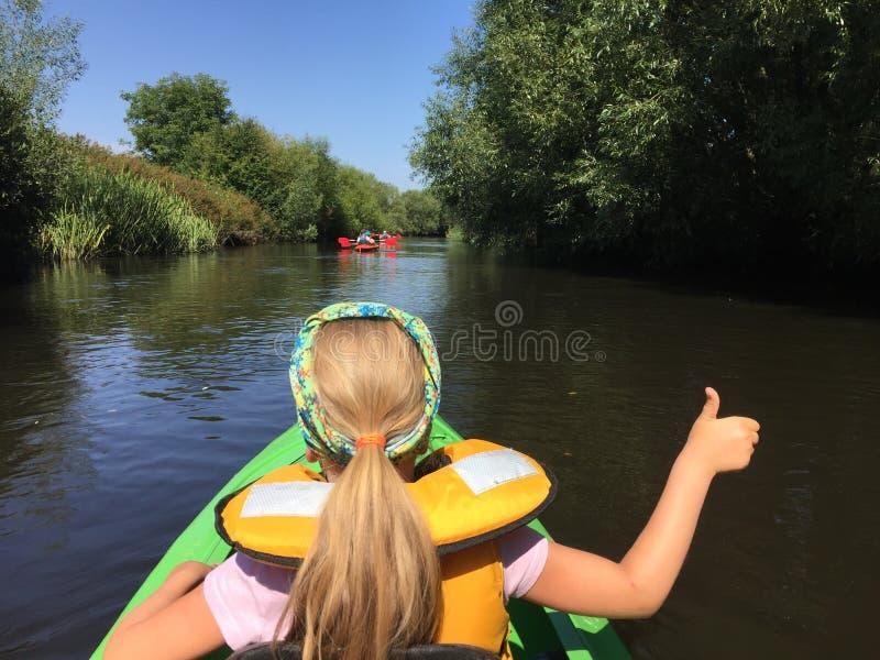 Girl in a kayak on Wieprza river, Poland stock photo