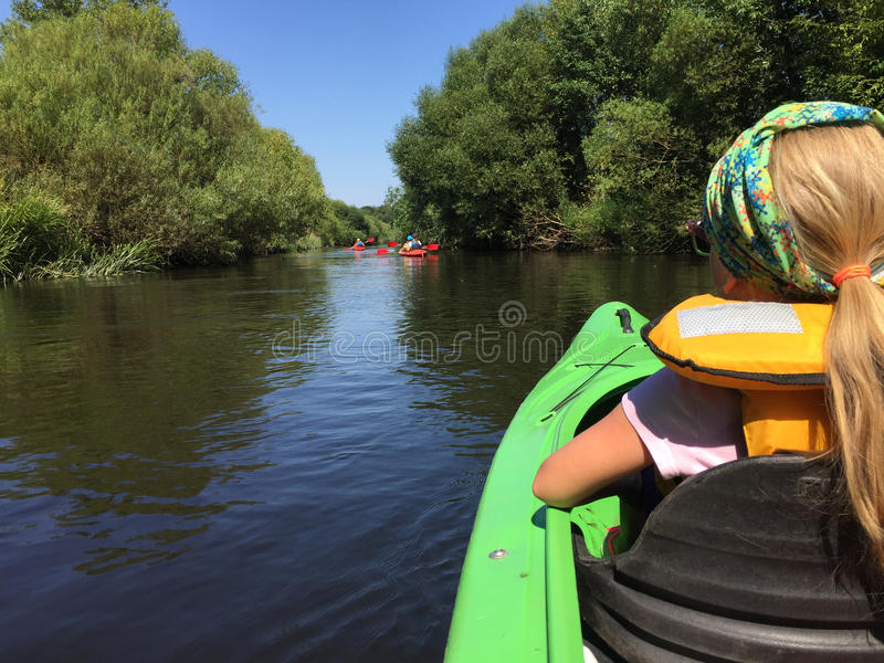 Girl in a kayak on Wieprza river, Poland royalty free stock images