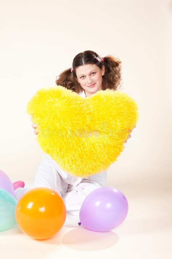 Download Girl keeps a yellow pillow stock photo. Image of multicolored - 26168206