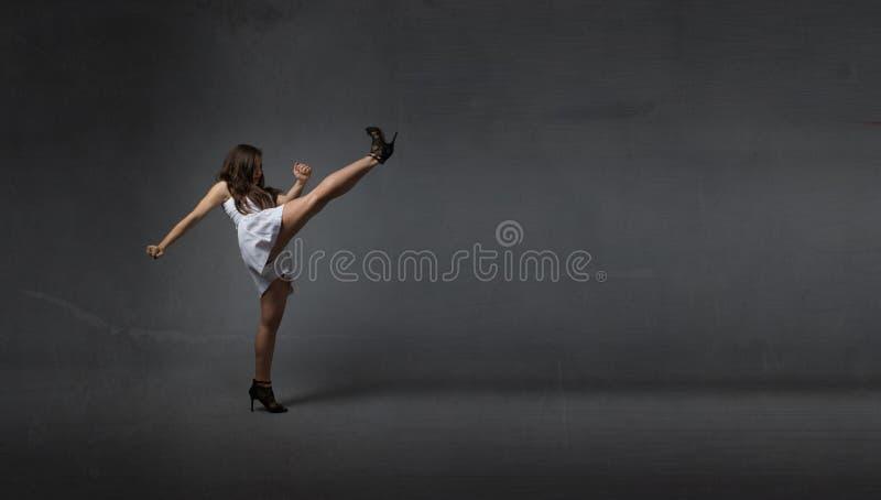 Girl kicking empty space stock photos