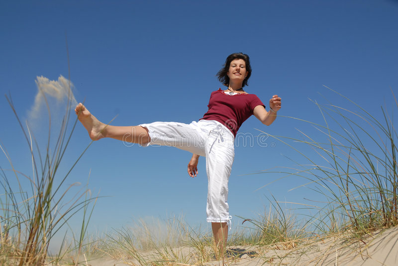 Download Girl kicking sand stock image. Image of freedom, healthy - 2494035