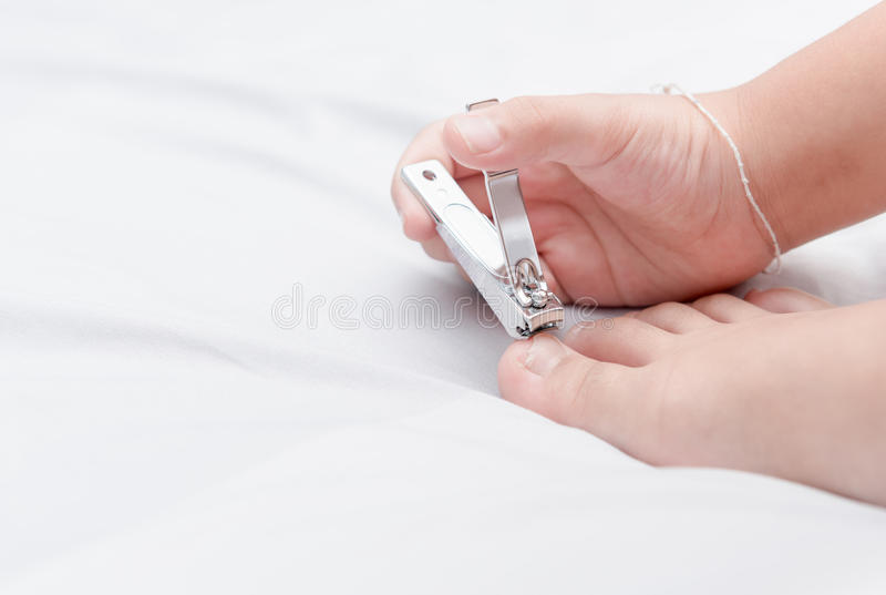 Girl Kid Cutting Toenail By Nail Clippers Stock Image - Image of ...